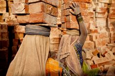 Kristine spent months photographing the brick kilns of India and Nepal. Here, in India, women balance stacks of bricks on their head in order to carry them to nearby trucks.