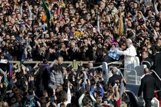 Pope Francis greets the crowd as he arrives in St. Peter's Square for his inauguration Mass, at the Vatican, on March 19.