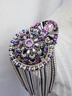 Luxurious novelty in the arsenal of author epaulettes - Epolete female purple Queen . Fresh design. Fashionable sparkling shades of this season 2018.) Epaulettes-an elegant addition to the classic things of your wardrobe. Its enough this one detail, so that your thing looks like a dress