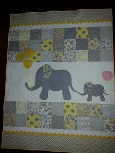 "Baby shower quilt gifted to Jennifer H for their first baby. She has an elephant theme and is having a girl. Used a pattern called. ""Mommy and Me"" pattern."