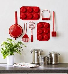 spray paint old kitchen utensils and hang on wall for a cute display!!