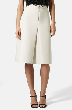 Free shipping and returns on Topshop Inverted Pleat Midi Skirt at Nordstrom.com. The exposed front zipper that secures the waistline of this crepe-crafted midi skirt releases into a crisp inverted pleat before finishing with a raw-edge hem.