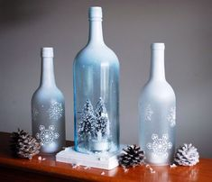 This is a set of hand frosted and painted wine bottles transformed into hurricane candle holders. The bottles have been hand cut and sanded to Glass Bottle Crafts, Wine Bottle Art, Painted Wine Bottles, Diy Bottle, Bottles And Jars, Glass Bottles, Decorated Bottles, Wine Glass, Christmas Wine Bottles