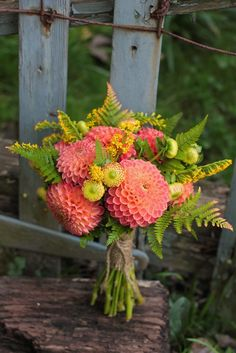 Bridesmaid bouquet with coral dahlias  [via lovenfreshflowers.com]