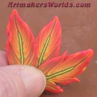 polymer clay feather cane hot pink and orange