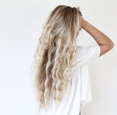 Wavy hair that has been released from plaits. Easy way to get waves in your hair is to plait your hair one or more times and leave to dry or sleep with the plaits in overnight. When you take the plaits out, your hair should be full of volume and waves.