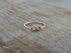 Hey, I found this really awesome Etsy listing at https://www.etsy.com/listing/113017618/infinity-knot-ring-silver-knot-ring-rose