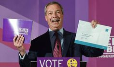 Nigel Farage with the Ukip manifesto