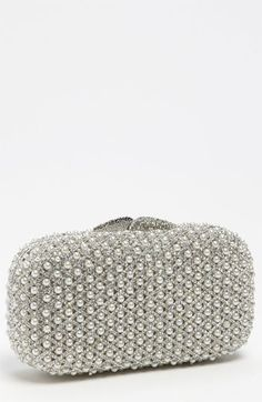 $298, Silver Embroidered Clutch: Natasha Couture Pearl Caged Clutch Silver. Sold by Nordstrom.