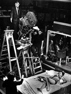 "Kubrick on the set of Dr. Strangelove / uncredited photo / ""Kubrick on a ladder presiding over a shot of Tracy Reed (...) who happens to have been the only woman who appeared in the nuclear farce. She plays Miss Scott, the secretary for Gen. ""Buck"" Turgidson (George C. Scott) but she also pops up in the movie as the woman in the centerfold of the Playboy magazine being read by Maj. T.J. ""King"" Kong (Slim Pickens)."""