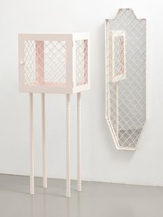 Cabinet and mirror in metal and metal mesh par Lotta Lampa