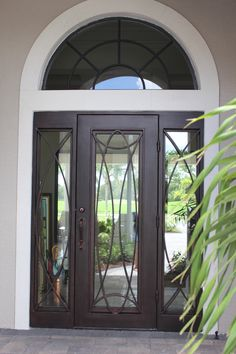 This single Regio iron door with sidelights is a door fit for a king. Order one today at suncoastirondoors.com!