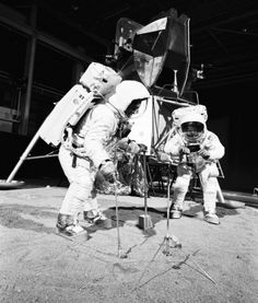Apollo 11 astronauts simulate gathering soil samples with tongs and scoop in Neil Armstrong holds the sample bag for Buzz Aldrin with a Lunar Module mockup behind them. Apollo 11 Crew, Apollo 11 Mission, Apollo Missions, Stanley Kubrick, Ufo, Moon Landing Conspiracy, Space Shuttle Missions, Apollo 11 Moon Landing, Apollo Space Program
