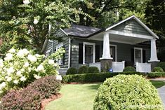 Nice cottage makeover. Love the color pallet and landscaping.