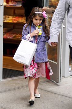 Head(Band) Over Heels  A rugged canvas jacket in a soft color palette (like lavender) keeps Suri's floral frock looking sweet without being overly girly. The polka-dot cuffs and a bow-bedecked headband make an ultra-cute addition.