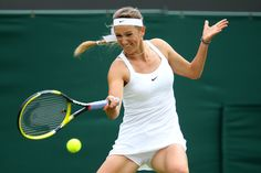Victoria Azarenka Photos - Victoria Azarenka of Belarus returns a shot during her first round match against Magdalena Rybarikova of Slovakia on Day One of the Wimbledon Lawn Tennis Championships at the All England Lawn Tennis and Croquet Club on June 20, 2011 in London, England. - The Championships - Wimbledon 2011: Day One