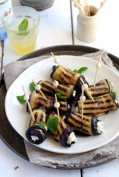 Eggplant roll ups stuffed with ricotta, cumin, mint and lemon