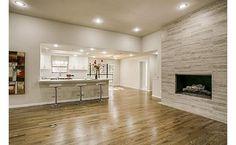 9609 Vista Oaks Drive, TX 75243 - fireplace, barstools