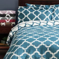 Update your bedding ensemble with the Lyon reversible duvet cover set featuring a 300-thread cotton-and-polyester blend.