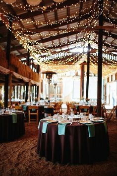 rustic farm barn venue lighting ideas / http://www.deerpearlflowers.com/rustic-barn-wedding-ideas/