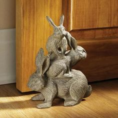 Hop on top! Weighty enough to serve as a doorstop and more than adorable enough to attract attention along a garden path or pond, this bunch of bunnies statue is an heirloom quality, Design Toscano-ex