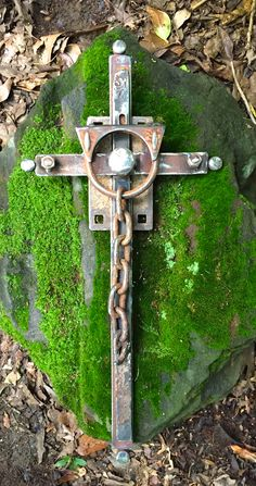 """He brought them out of darkness, out of utter darkness, and He broke away their chains.""  Psalm 107:14  A cross made from old industrial scrap iron and broken chain. By Birmingham metal artist Catherine Partain Shamblin, 2015."