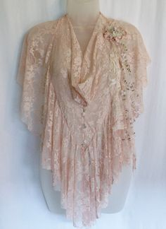 This little lace cover up is perfect for summer time~ just enough to cover up your shoulders and keep the chill away. It simply slips over your head and you are ready to go. The front drapes like a cowl neck and Ive put together a shabby flower which sits on your left shoulder. Youll look feminine, romantic and pretty in pink!!! She is ready and waiting to be shipped out today :)  Any questions? Just ask :) Thanks so much for looking