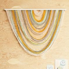 Make this cute little wall hanging with scraps of yarn for a small piece and large strands for a statement piece! via for the love of