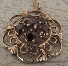 Vintage 9ct Gold and Garnet Pendant with Gold Chain London Hallmark 1978 - 21.5mm diameter 4.3 grams - FREE UK POSTAGE. by ScotiaVintageJewelry on Etsy