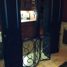 Fireplace screen used as dog gate