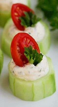 CUCUMBER TOMATO BITES WITH CREAMY PARMESAN HERB SPREAD ~~~ These fresh, crunchy cucumber bites with a heavenly garlic-herb cream will be the hit of every party! They are so easy to make, colorful and perfect for any occasion between Christmas and backyard summer bashes.