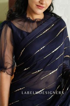 20 Stunning blouse designs with net - Simple Craft Ideas Netted Blouse Designs, Saree Blouse Neck Designs, Fancy Blouse Designs, Bridal Blouse Designs, Latest Blouse Neck Designs, Net Saree Blouse, Black Saree Blouse, Net Blouses, Designer Blouse Patterns