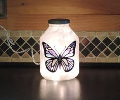 Handcrafted nightlight with blue monarch by RecycledGiftsofGlass