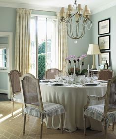 Duck egg blue dining room with beautiful cane backed chairs. by Anne Hepfer Designs - BWE