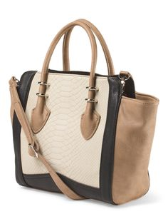 The color blocked neutrals on this satchel make it versatile and chic.