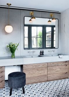Modern gray and wood bathroom with patterned tile floor.