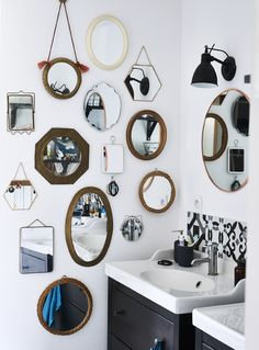 Use your favourite collection to create a display. In France, Marion has been collecting vintage mirrors for years. She's used them to decorate her bathroom wall. Get more ideas from homes at IKEA.com #IKEAIDEAS