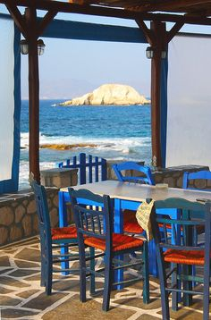 a picturesque tavern at the sea front, somewhere in Greece