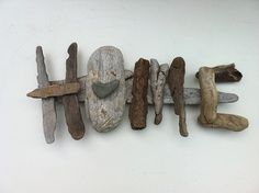 "beachcomber driftwood: we could make a couple of these signs for the garden. Paint them bright, cheery colors and have them say ""FUN"" ""HAPPY"" ""SUNNY"" ""HEART"" etc..."