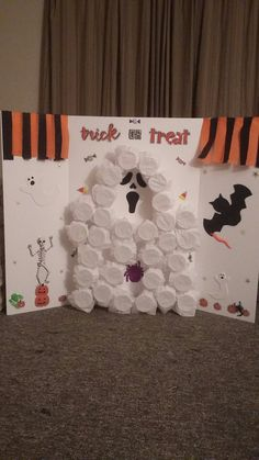 Game we made for a Halloween party, at my son's preschool. Each child pokes their hands through for a surprise. I used a folding foam poster board, just like a science fair project board. Plastic cups with tissue paper glued on top. I put spider rings, bat rings, stretchy skeletons, and vampire teeth inside the cups. Halloween stickers and streamers to decorate. Hot glued it all together. We picked a ghost shape for the cups. I have seen it done in the shape of a pumpkin too.