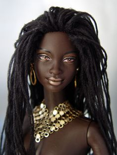 African-American Barbie sized doll with dreadlocks. http://tabloach.auctivacommerce.com