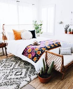 Omg the mix of textures and splashes of colors and textures! Love it! The different pillows. Would decorate with different plants but still. Loveellyy