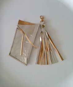 Set . Leather gold case for glasses . Gold case for sunglasses . Keyring with gold leather fringed .Tassel . By Lara Klass