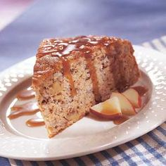 This moist apple- and nut-filled cake recipe is drizzled with sauce for extra sweetness.