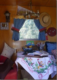 Sisters on the Fly...cute western decor in this vintage camper