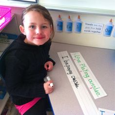 Practicing correct letter formation using laminated sentence strips