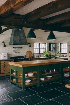 Dark Green Kitchen Island in Rustic Kitchen In a nod to Christmas, I'm featuring rooms that are decorated with dark green. You'll find the color creates warm and cozy living spaces. Green Kitchen Island, Dark Green Kitchen, Kitchen Islands, Rustic Kitchen Island, Rustic Country Kitchens, Küchen Design, House Design, Cozy Living Spaces, Living Rooms