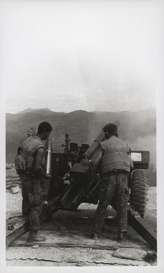 """105mm Howitzer Crew, 1969 """"105: Members of a 105mm howitzer crew complete a fire mission at Fire Support Base Russell, northwest of the Rockpile. The fire mission was in support of the 2d Regiment, 1st Division Army of the Republic of Vietnam (ARVN), who were participating in search and clear operations (official USMC photo by Corporal G. N. Zimmerman)."""" From the Jonathan Abel Collection (COLL/3611), Marine Corps Archives & Special Collections. OFFICIAL USMC PHOTOGRAPH"""