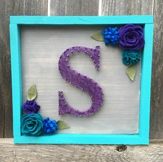 Letter/Initial Nail and String Art Wood Sign with Felt Flowers by BrittonCustomDesigns on Etsy https://www.etsy.com/listing/345249854/letterinitial-nail-and-string-art-wood