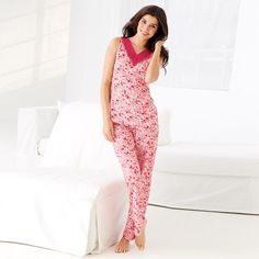 Say goodnight in style in this cozy pajama set of light rose pink with dark red and rose colored floral prints. Top features a v-neck with red mesh trim/lace on collar. Full length pants feature an elastic waist band. Body: 90% Polyester, 10% Spandex / Mesh: 100% Nylon. Machine wash. www.youravon.com/margidonaldson